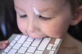 boy eats keyboard